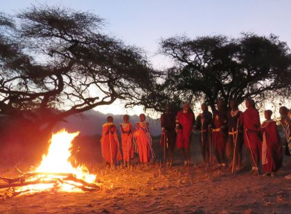 In the evening, we gather round the campfire for a special farewell celebration to our unforgettable adventure in Tanzania.