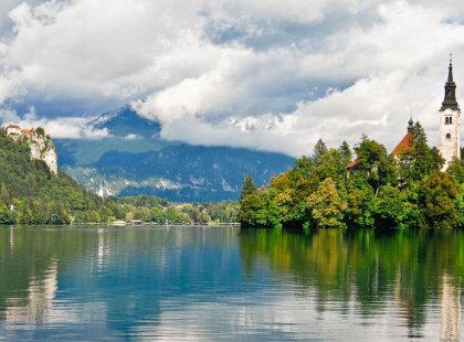 A walk along picturesque Lake Bled affords views of the baroque Church of the Assumption and medieval Bled Castle perched on the cliffs above.