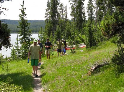 We stretch our legs on a trail that traverses the western shore of beautiful Shoshone Lake.