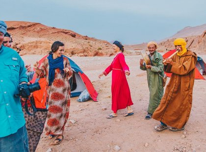 Travellers and Berbers dancing at Sahara Desert Camp, Morocco