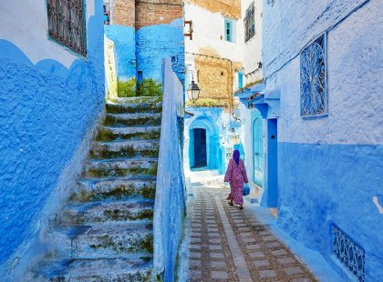 morocco chefchaouen blue alley woman walking