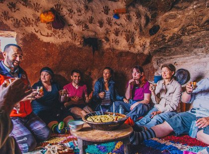 Group of travellers sharing traditional Berber food, Morocco