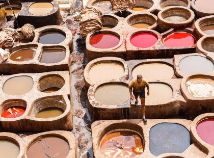 Close up view of local man at leather tanneries, Fes, Morocco