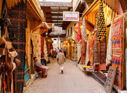 Local man walks through market street, Fes, Morocco