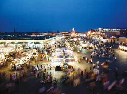 Djemaa El-Fna busy market at night, Marrakech, Morocco