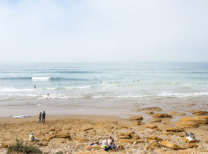 Surfers in the sea in Taghazout, morocco