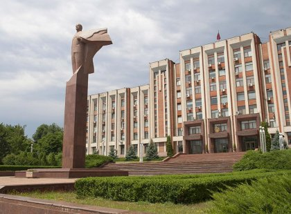 A statue of Lenin looms over the front of the Supreme Council of Transnitstria