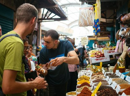 Travellers looking at spice market, Israel