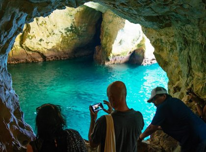 Group of travellers viewing grotto cave, Rosh Hanikra, Israel & the Palestinian Territories