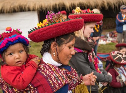 Local mother and child in traditional dress, Sacred Valley community visit, Peru