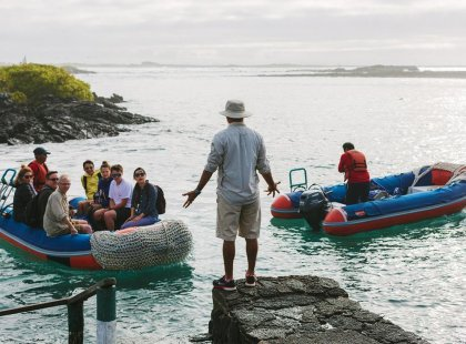 Group travellers and tour leader, panga boat rafts, Galapagos Islands