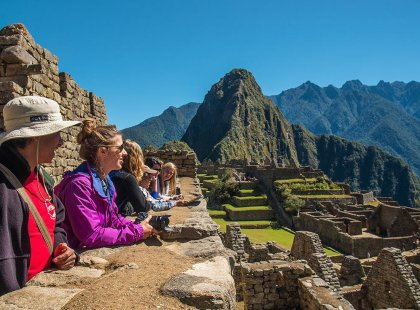 Intrepid travellers and group leader lookout at Machu Picchu, Peru