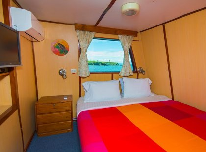 An upper deck double room on Daphne, our Galapagos vessel